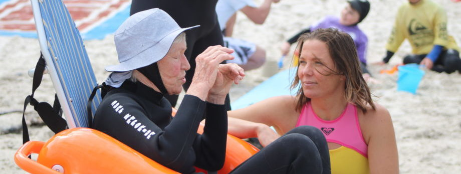 Roxy and adaptive surfer Pamela discussing the upcoming surf therapy session